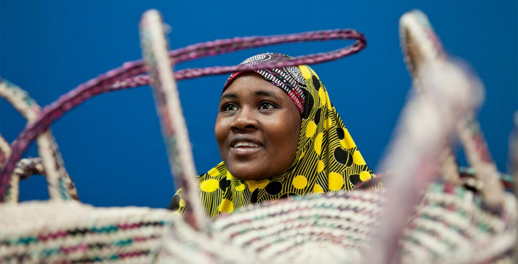 A woman smiles while wearing traditional garb.